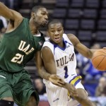 Tulsa guard Ben Uzoh (1) tries to get past UAB forward Lawrence Kinnard (21) in the second half of an NCAA college basketball game at the Conference USA men's tournament in Memphis, Tenn., Friday, March 13, 2009. Tulsa won 70-67 and will face Memphis in the championship game Saturday. (AP Photo/Mark Humphrey)